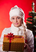 Miss santa claus with christmas present — Stock Photo
