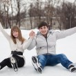 Couple having fun on ice skate rink outdoors. — Stockfoto #9577719