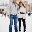 Couple on ice skate rink outdoors. — Stock Photo #9577732