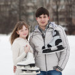 Couple on ice skate rink outdoors. — Stock Photo #9577772
