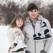 Couple on ice skate rink outdoors. — Stock Photo #9577820