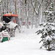 Small tractor snow removal - Stock Photo