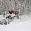 Small tractor snow removal in the park — Foto Stock
