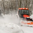 Two tractor snow removal in the park — Stock Photo
