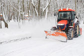Winter snow removal a small tractor — Stockfoto