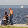 Disabled in wheelchairs on the embankment - Stock Photo