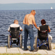 Disabled in wheelchairs on the embankment — Stock Photo
