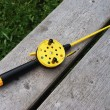 Fishing rod with yellow reel — Stock Photo