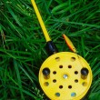 Fishing rod with yellow reel — Stock Photo #8031290