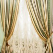 Window with striped curtians and  tulle — Stock Photo