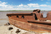 Rusty ship on the shore — Stock Photo