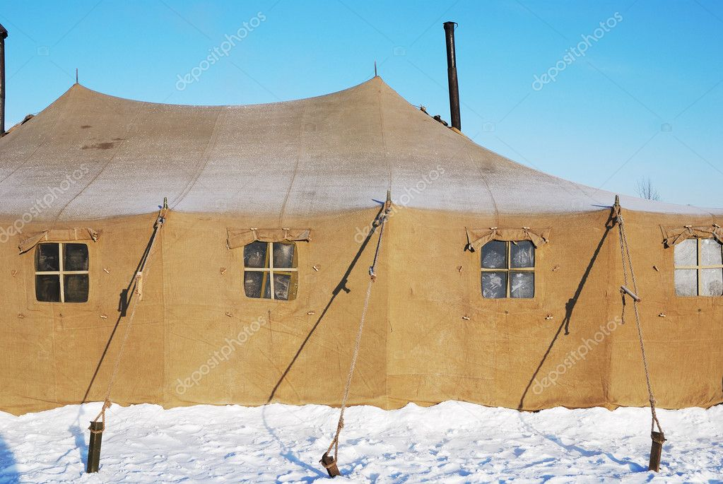 Military tent with frozen windows in winter — Stock Photo #9140603