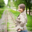 Girl standing on the railroad — ストック写真