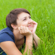 Young Woman relaxing on the green grass — Stock Photo #8986524