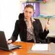 Business womsitting in office in front of laptop — Stock Photo #10228037