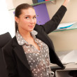 Business woman sitting in the office — Stock Photo #10228062