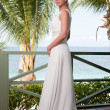 Beautiful bride on tropical sea side background — Stock Photo #10475192