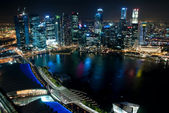 Business center of Singapore at night — Stock Photo