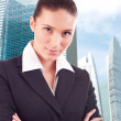 Young business woman over business center background — Stock Photo #8191696