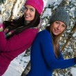 Beautiful young women outdoor in winter plaing snawballs — Stock Photo