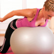 Young woman in sportswear, doing fitness exercise with fit ball — Stock Photo #8499109