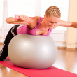 Young woman in sportswear, doing fitness exercise with fit ball — Stock Photo #8499116
