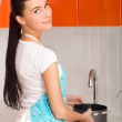 Young woman filling stewpan with water — Stock Photo #8624063
