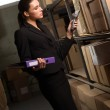 Business woman stock counting in warehouse — Stock Photo #8624080