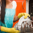 Attractive brunette woman cleaning kitchen using dish washing ma — ストック写真