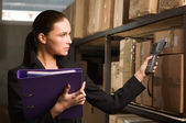Business woman stock counting in warehouse — Stock Photo