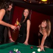 Group of happy girls playing in billiard — Stock Photo #8928082