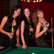 Group of happy girls playing in billiard — Stock Photo #8928083