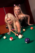 Happy girls playing in billiard — Zdjęcie stockowe