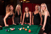 Group of happy girls playing in billiard — Stock Photo