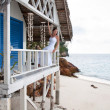 Young woman on tropical beach house — Stock Photo #9251315