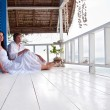 Romantic young couple in tropical beach house — Stock Photo #9450576