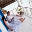 Romantic young couple in tropical beach house — ストック写真