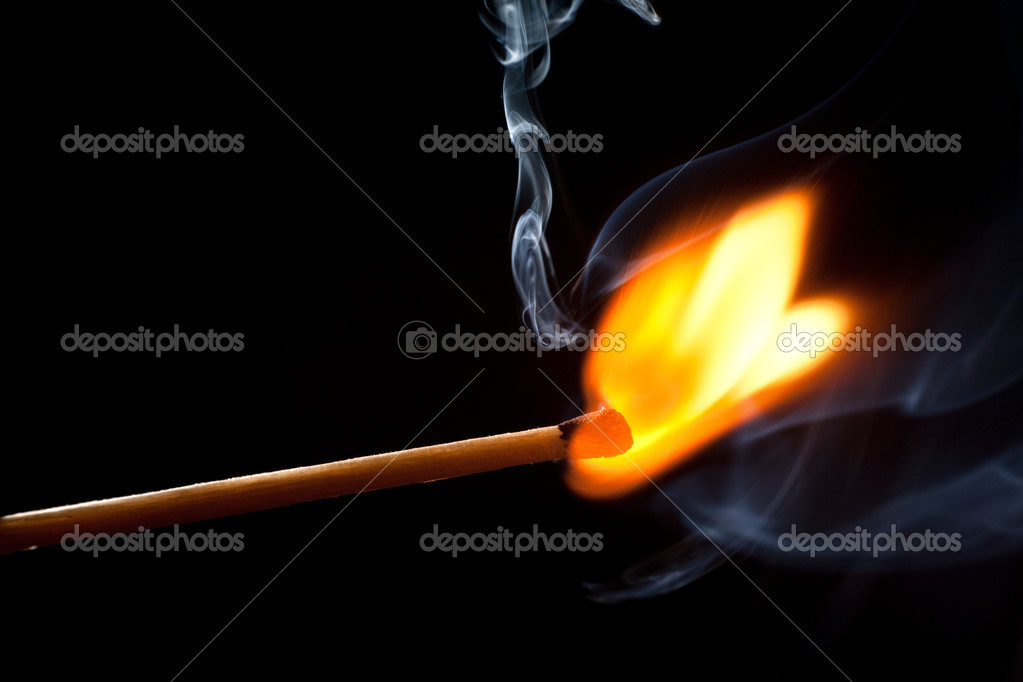 Burning match on a black background  Stock Photo #8879564