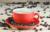 Cup of coffee with roasted beans — Foto Stock