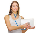 Young smiling girl with laptop and stethoscope — Stock Photo