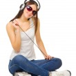 Young girl listen music by headphones — Stock Photo #8738797