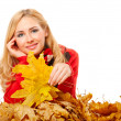 Young woman with autumn leaves — Stok fotoğraf
