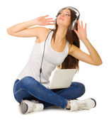 Young girl listen music — Stock Photo