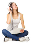 Young girl listen music — Stock Photo