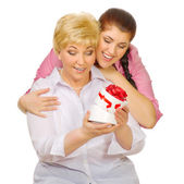 Senior and young woman with gift — Stock Photo