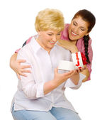 Young woman give gift to her mother — Stock Photo