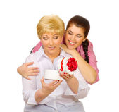 Senior and young women with gift — Stock Photo