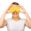Young girl with orange slices — Stock Photo #9858124