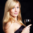 Young woman with champagne over dark background — Stock Photo