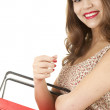 Smiling girl with shopping basket — Lizenzfreies Foto